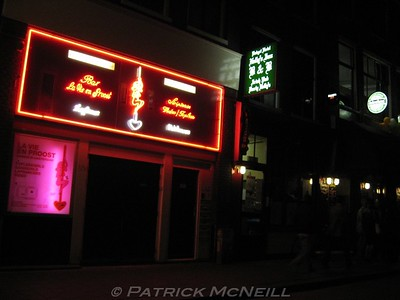 My hostel (the green sign, Durty Nellie's) beside a strip club, I was staying right in the middle of the red light district
