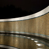 "<center>The Freedom Wall is on the west side of the memorial, with a view of the Reflecting Pool and Lincoln Memorial  behind it. The wall has 4,048 gold stars, each representing 100 Americans who died in the war. In front of the wall lies the message ""Here we mark the price of freedom.</center>"