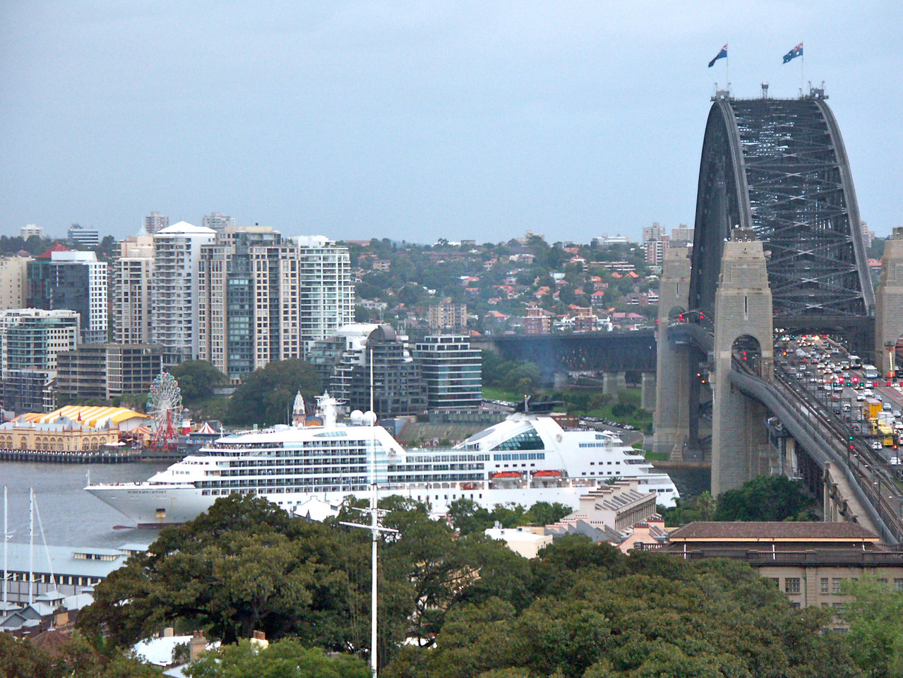 odyssey sailing under harbour bridge