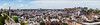Aerial panorama of Baltimore from the inner harbor from the Shot Tower to the Hopkins medical complex.