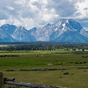 This panoramic photo displays the full length of the Teton range.