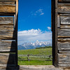 The view of the Teton range from a window in the Shane cabin