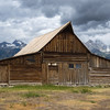 The second Mormon barn--the peak of its roof imitates that of some of the peaks of the Tetons in the distance.