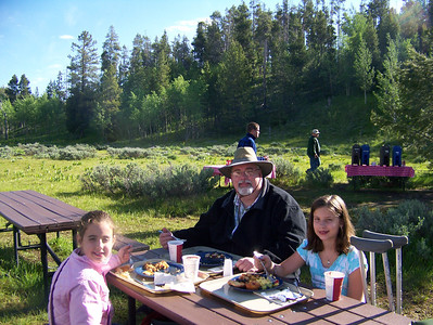 Yellowstone Vacation - Grand Teton National Park - Jackson Lake Area - Kevin, Anna and Abigail having breakfas on Elk Island