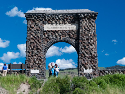 Yellowstone Vacation - Mammoth Springs Area - Kevin, Pam, Abigail and Anna at Roosevelt Arch