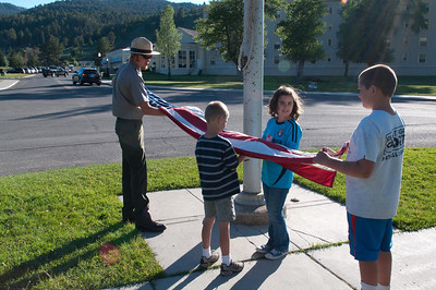 Yellowstone Vacation - Mammoth Springs Area - Anna helping to lower the flag over the park headquarters.