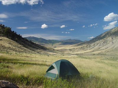 A campers dream.  A tent set up with a spectacular view in Yellowstone National Park.