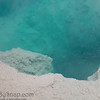 Peering into the boiling blue water of a hot spring in Yellowstone National Park.