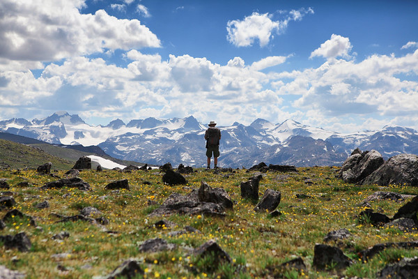 Archaeologist Dr. Richard Adams from the University of Wyoming looks onto the Continental Divide in Wyoming's Wind River Range. This area is completely unexplored by archaeologists and holds important information regarding past people and climate of the Greater Yellowstone Ecosystem.