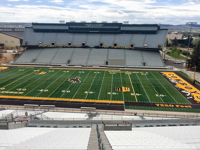 """Laramie, Wyoming houses the University of Wyoming.  I attemped to walk/jog up the steps one morning.  That did not last long.  I love the """"7220 Feet"""" reminders. on the field."""