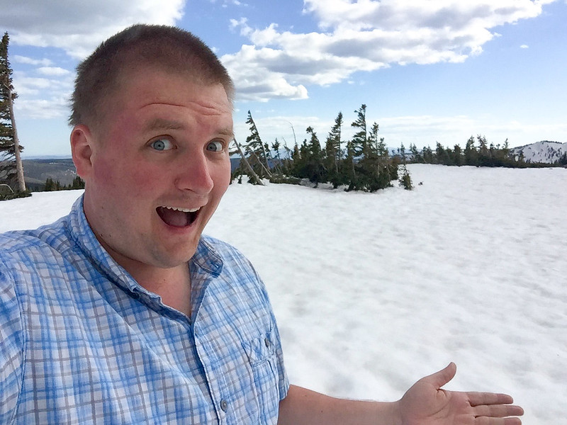 Snowy Range - a mountain pass near Laramie.  Notice my look of excitement about seeing snow.  Later in the trip, I would be less enthusiatic about the frozen menace!