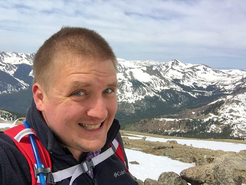 Me trying to look cool while trying to breathe as I hike straight up through snow at 13000' feet.  That view though!