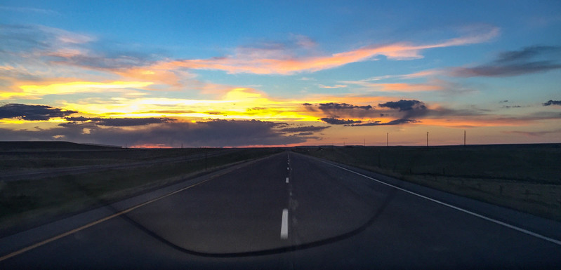 A beautiful Wyoming sunset as I drive down a lonely road.  Just ignore the reflection of my windshield...and the fact that I was taking a picture while driving...and the fact that I was driving in the middle of the road...