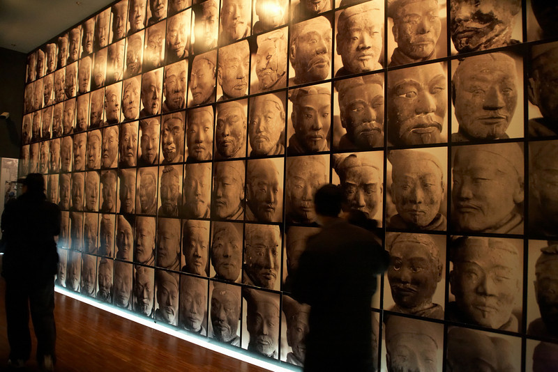 This wall of photos shows some of the many unique faces that make up the terracotta army.