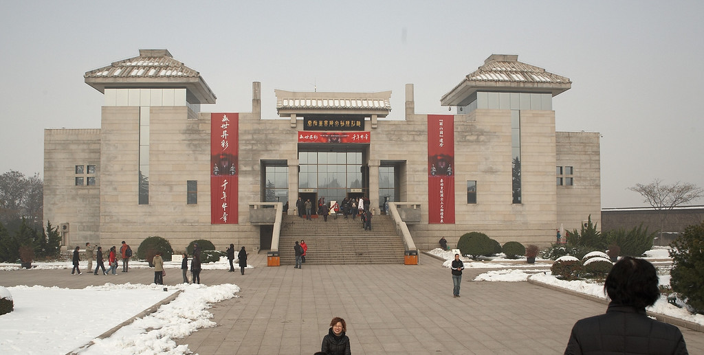 This is Emperor Qin's Terracotta Army Museum. The terracotta soldiers were discovered in 1974 by local farmers drilling for water. It is located at the east of Xi'an, about 50 minutes by bus. According to historians, construction of this spectacular mausoleum began in 246 BC and buried with Emperor Qin in 210-209 BC. It's worth noting that Emperor Qin was only 13 when construction began. He was certainly thinking ahead!