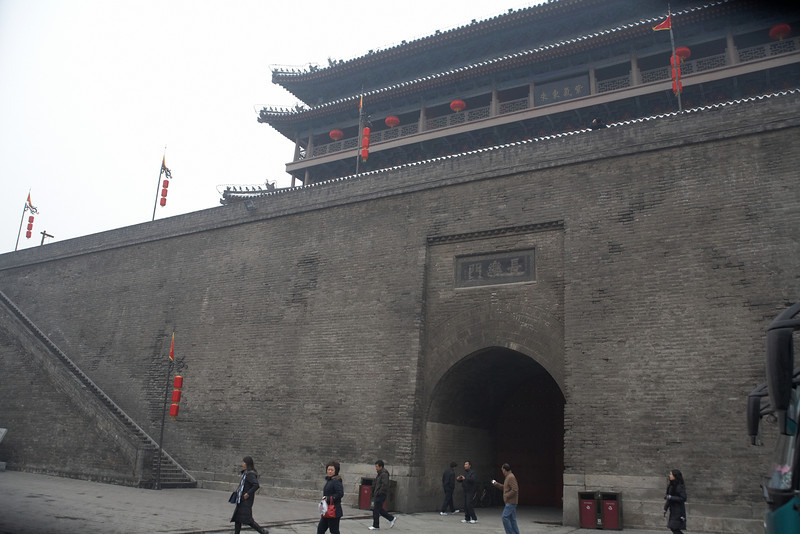 The east gate of Xi'an. The Xi'an city wall is the only city wall in China that has survived completely intact. It is also an example of one of the largest ancient military defense systems in the world. The wall is about 12m high and 15-18m thick at its base.