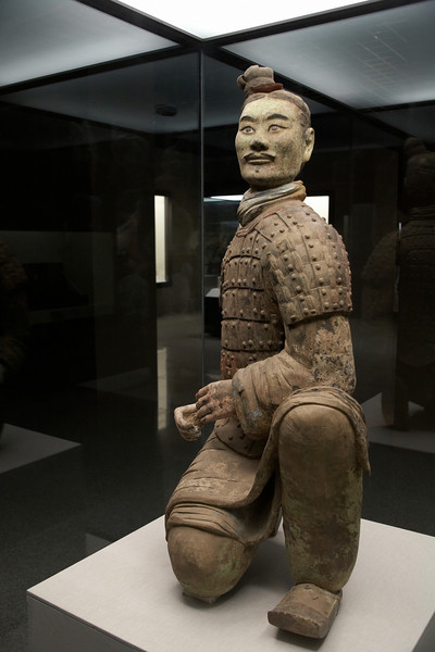 This is the green faced terracotta warrior. All the other unearthed terracotta warriors had pink faces. He was originally holding a bow. Experts haven't reached agreement on why his face is green. He is part of the forward element of the army.