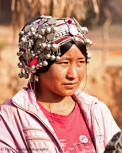 Akha Woman Wearing Traditional Hat With Silver Decorations