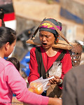 Akha Woman Bargaining Over Oranges With A Mouthful of Betel Nut