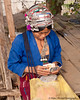 Akha Woman Counting Her Money While At the Xieng Kok Market