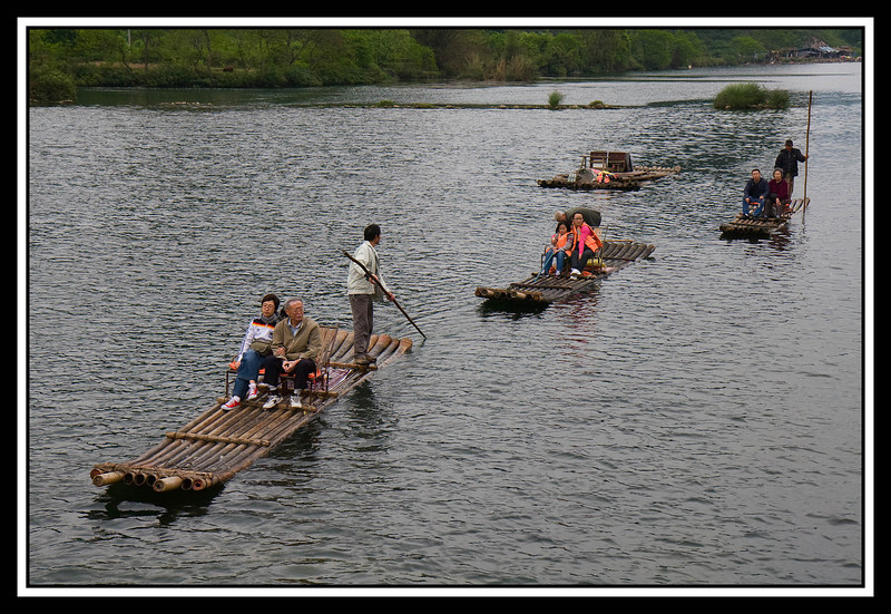 Bamboo tour rafts on tributary of Li River...