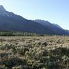 Grand Tetons above Wyoming shrublands.