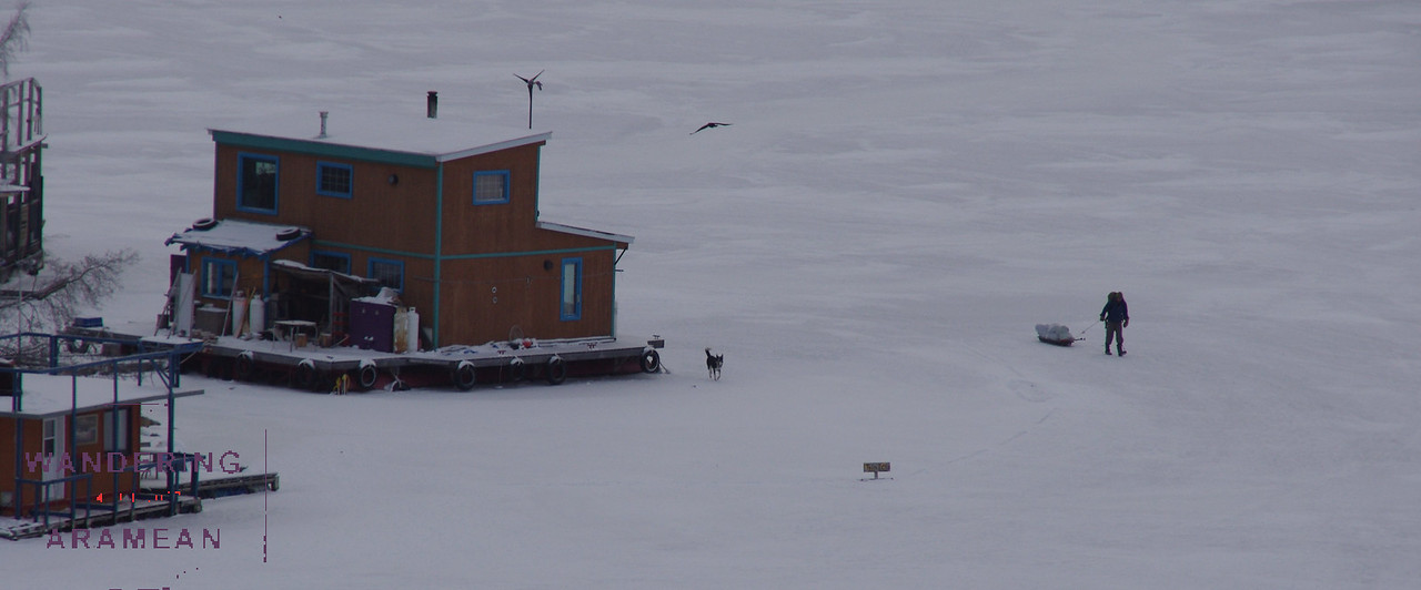 A houseboat, frozen in the lake