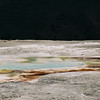 Mammoth Hot Springs - travertine pool.  I have no clue why the sky came out black here but it makes a hella photo.