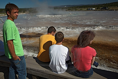 The family on its first geyser vigil, waiting for the Great Fountain Geyser to erupt. Word had it that it was due around 10:15am. It didn't disappoint.  Fire Hole Lake Dr., Yellowstone Natl. Park, 30Jul10