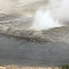 geyser by the stream