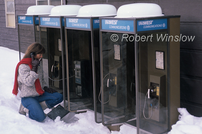 MR, Woman making a phone call from outdoor phone booth, Winter, 1990, Old Faithful area, Yellowstone National Park, Wyoming, USA, North America