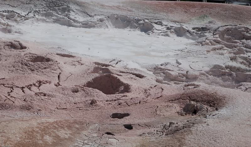 The Fountain Paint Pots are a group of mud pots located between the Midway and Lower Geyser basins in Yellowstone National Park and are named for the reds, yellows and browns of the mud pots in this area. The differing colors are derived from oxidation states of the iron in the mud