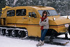 MR, Woman resting by Snow Coach, Winter, Yellowstone National Park, Wyoming, USA, North America