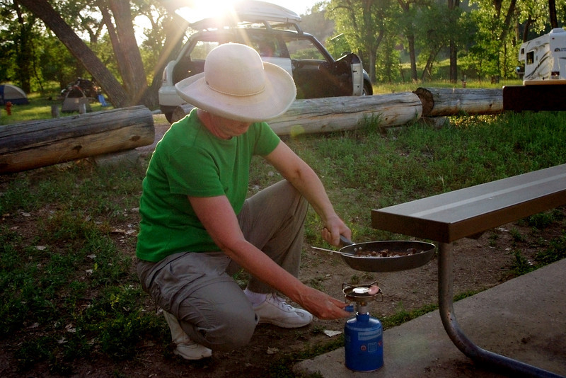 Rita cooking on the camp stove, Devil's Tower National Monument, South Dakota.