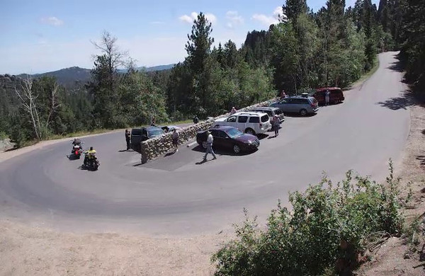 Click to watch a short video of motorcycles navigating a hairpin curve on The Needles Highway in Custer State Park, South Dakota. <br /> <br /> (Look for the DVD button at the top of the video window to make the movie bigger, and find the Close button in the upper right corner to return to this page.)