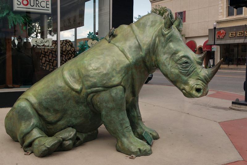 Bronze statue of Rhinoceros with tickpicker birds by Dollores Shelledy. Sheridan, Wyoming.