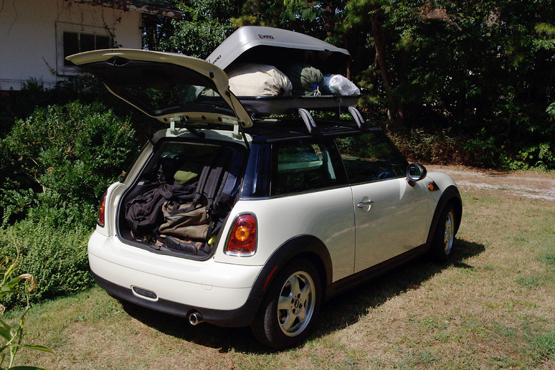 Yes, it is possible to fit a camping outfit for two in (and on) a MINI Cooper, but there is not much room to spare.