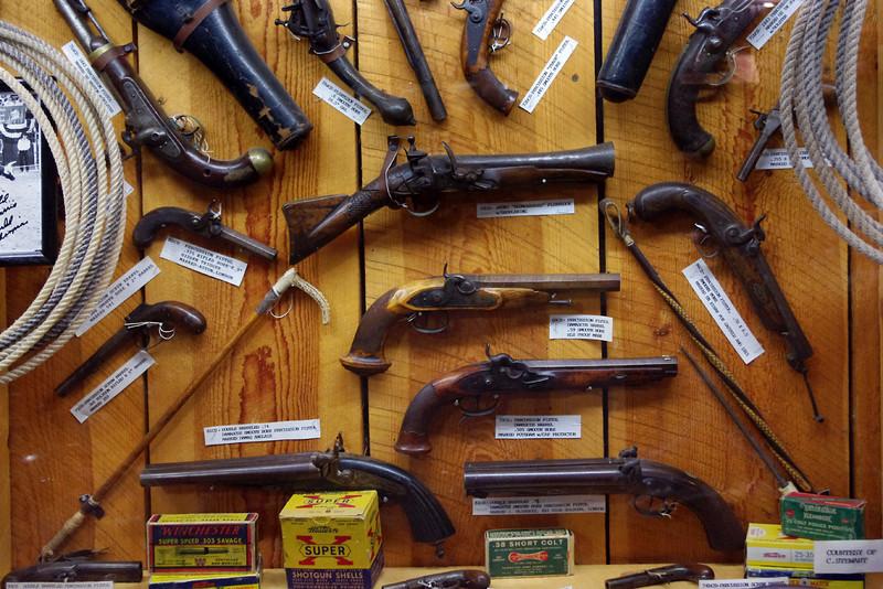 Pistol display, cowboy museum Inside King's Saddlery, Sheridan, Wyoming.