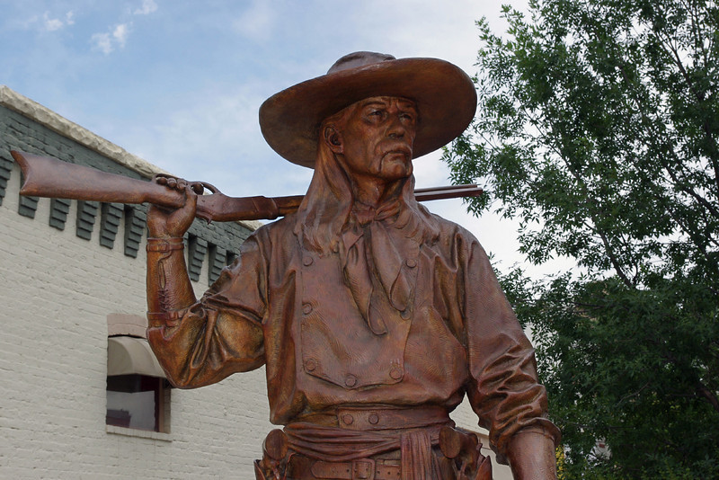 """Sheridan, Wyoming has quite a collection of bronze statues on its public streets, including this one: """"Bozeman Scout"""" by artist Barry Eisenach."""