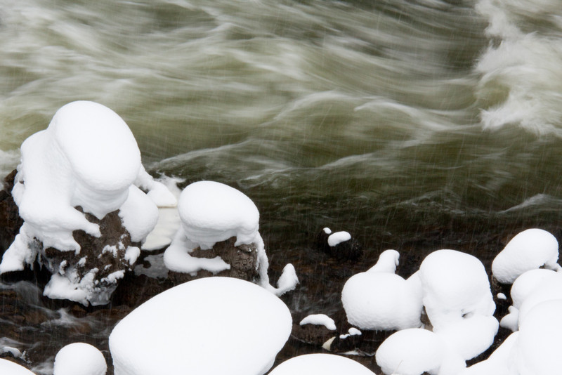 Firehole river, snow on bank and falling