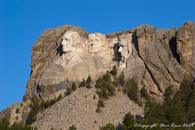 Along the highway with a different view of Mount Rushmore.
