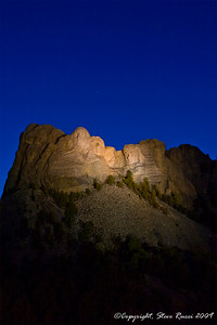Mount Rushmore National Monument at night.
