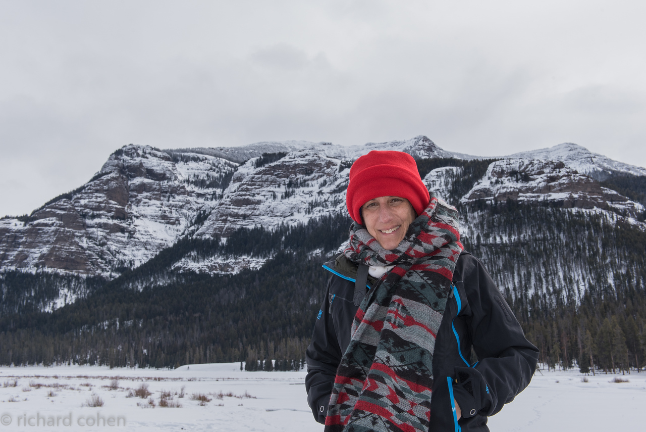 Lisa in front of Beartooth Mtns at NE end of Yellowstone. Not too cold this day.