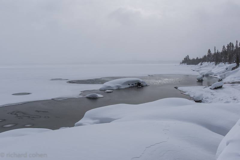 Yellowstone Lake, a couple of geothermal features keeping this small section from freezing over.