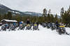 Snowmobile tours at the Madison warming hut rest stop.  All snowmobiling in Yellowstone is tightly regulated, requiring a guide, limiting the number of machines a day, and the noise level of the machines.