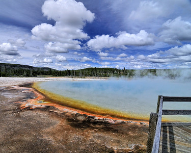 """Sunset Lake, Black Sand Basin, Lower Geyser Area, Yellowstone.  The various color bands are not caused by mineral deposits as I thought but by thermophiles (heat-loving micro-organisms).  True """"Living"""" color."""
