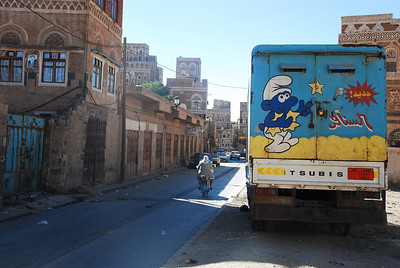 I like this one because of the Smurf in Arabic and the timeless old house in the background.