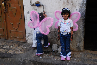 Two little girls who loved their new wings they'd received as Eid presents.
