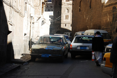 Sana'a's alleyways were built wide enough for two loaded camels to pass each other.  Cars have a problem, seeing 3 or 4 cars reversing out of alley because it was blocked wasn't unusual.