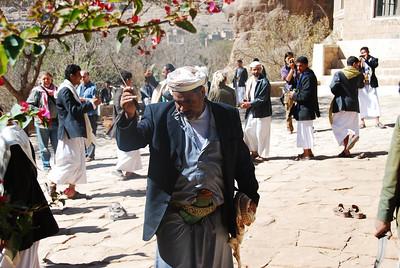 Men dancing in the courtyard of Dar al-Hajjar.